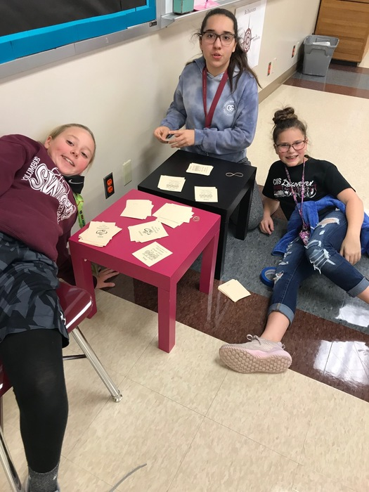 Student Council members sorting locker signs.