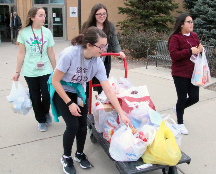 CMS students haul food for the Platte County Food Pantry.