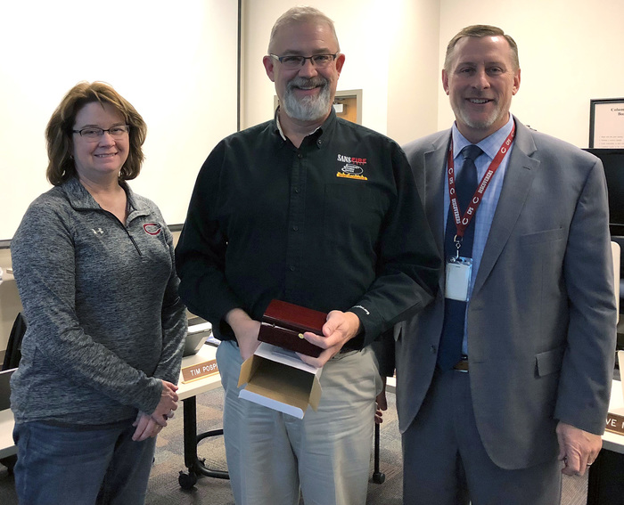 Tim Pospisil was honored for his years of service by the Board of Education.