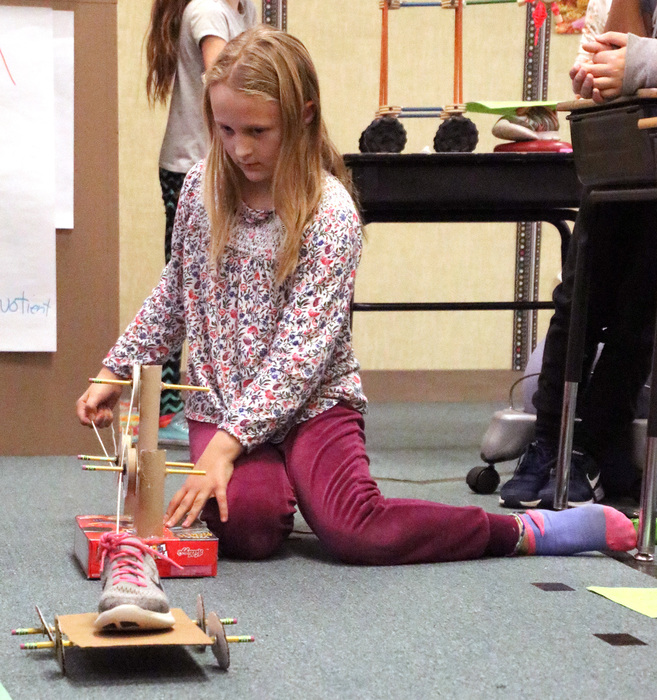 Lost Creek fourth graders demonstrate their simple machines.