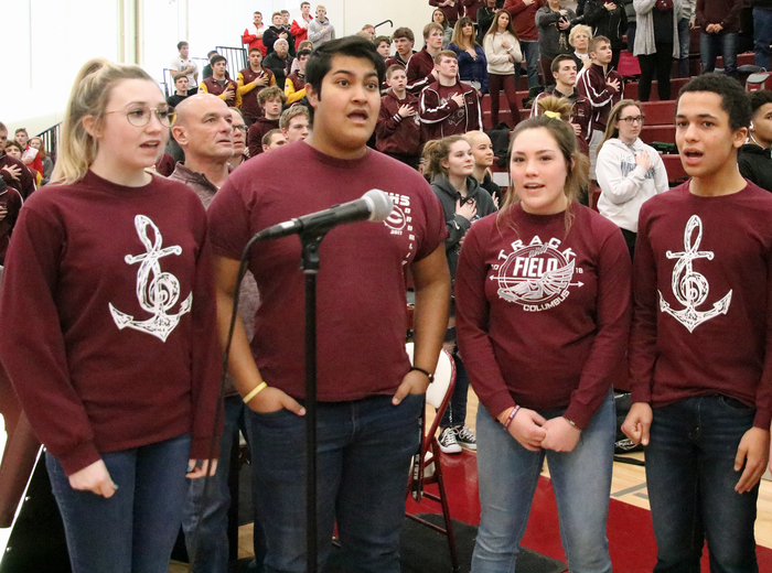 Singing Star Spangled Banner at district wrestling
